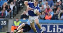 Laois' John O'Loughlin escapes the clutches of Dublin'sMichael Darragh Macauley. Photograph Morgan TreacyInpho
