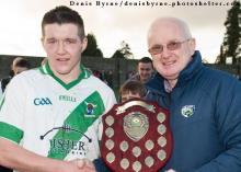 Captain Patrick Keating is presented the U21 Hurling Championship B Plague by Laois County Chairman Gerry Kavanagh on Saturday.