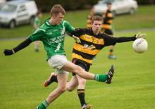 Killeshin Crettyards Cormac Murphy sends this ball in as The Heaths David Conroy looks to block. Photo Denis Byrne.