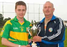 Captain Denis Cahill being presented by Laois County Boards Danny Gorman. Pic Denis Byrne.