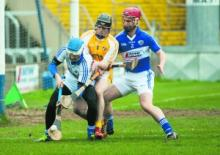 Eoin O'Reilly and John A. Delaney combine to deny any scoring chance for Antrims' Ciaran Clarke. Photo Denis Byrne.