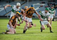 Camross' Martin Burke in possession as Portlaoises' Cian Taylor and Chris Lynch close in. Photo Denis Byrne.
