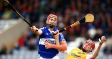 Laois' John A Delaney battles for possession with Antrim's PJ O'Connell during the Leinster senior hurling qualifier r