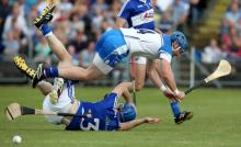 Shane Walsh hurdles the challenge of Brian Campion