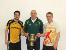 Peter Whelan and David Mulhall being presented with the Martin Mealy Cup by Monavea Handball Club Chairperson Joe Brennan.