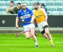 Laois' Ross King gives Antrims' Conor McKinley the slip during their N.H.L clash. Photo Denis Byrne.