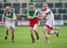 Borris Kilcottons' Joseph Campion on the break as Rathdowney Errills' Joe Fitzpatrick challenges. Photo Denis Byrne.