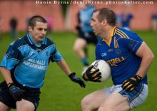 2013 Laois IFC - Annanoughs Colin Miller on the attack as Ballyroans Niall Wallace moves to challenge. Pic Denis Byrne.
