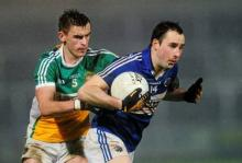 Conor Meredith, Laois, in action against Eoin Carroll, Offaly