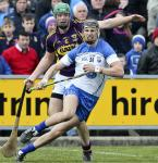 Waterford's Maurice Shanahan in possession against Wexford's Matthew O'Hanlon during their National Hurling league match in Wexf