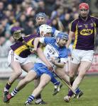 Waterford's Colin Dunford with the sliothar against Wexford's Liam Ryan during their National Hurling league match in Wexford Pa