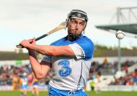 The concentration on the face of Waterford's Pauric Mahony as he strikes for the winning point from a free on Sunday last.