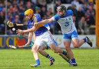 Waterford's Jake Dillon about to dispossess Tipperary's Shane McGrath.
