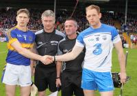 Referee Barry Kelly with Waterford captain Kevin Moran and Tipperary captain Brendan Maher.