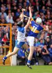 Fingertip control from Waterford's Jamie Barron over the head of Tipperary's Brendan Maher.