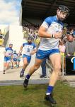Waterford captain Kevin Moran leads his teamout for the game.