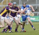 Waterford's Pauric Mahony with the sliothar against Wexford's Paudie Foley and Garrett Sinnott during their National Hurling lea