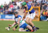 Waterford's Kevin Moran blocks Tipperary's James Woodlock.