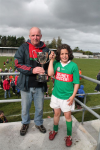 Vinny OHora presenting the Tom McDonnell Cup to Rory Morrin captain of the Ballina Stephenites U10A Team