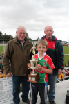 Jackie Wynne presenting the Sean Wynne Cup to Dylan Neary captain of the U8A Ballina Stephenites team.