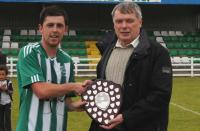 St. Catherines captain Jason Noctor pictured receiving the Donegal Area Shield from League Executive George Mc Mullin.