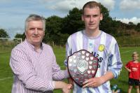 DJL Secretary Jimmy Haughey pictured presenting the Gweedore Area Shield to Chris Duffy, captain of Cranford United