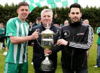 Jason Noctor receives the Brian Mc Cormick Cup from Sean Og and Jimmy Haughey, Secretary, Donegal Junior League