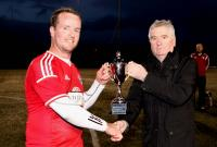 Jimmy Haughey, League Secretary pictured presenting the Saturday Division One Cup to Michael Ward of Erne Wanderers