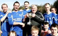 League Administrator Terry Leyden pictured presenting the Glencar Inn Saturday Division Two Trophy to Deele Harps captain Gary C