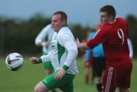Christopher Burke and Kyle Lafferty compete for the ball during the Cappry Rovers v Letterbarrow Celtic match