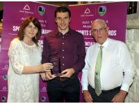 Eileen O'Flynn of Auld Triangle presenting Tom Kenny with his June Award