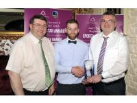 Sean O'Sullivan being presented with April Award by Michael McSweeney of Auld Triangle and John Feeney Awards Committee