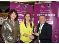Eileen O'Flynn of the Auld Triangle presenting Rhona Ni Bhuachalla with award, also Dave Lee MCB
