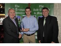 Michael O'Riordan presenting Fintan Goold with his April Award, John Feeney Chairman of the Awards committee