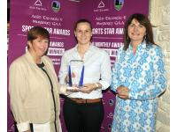 Aoife  being presented with the July Award by Anne O'Riordan Secretary Awards Committee and Eileen O'Flynn of The Auld Triangle
