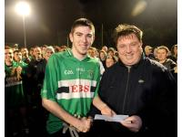 Man of Match Luke Connelly receiving award from Shay Livingstone Manager Rochestown Park Hotel