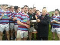 Chairman Carbery Board Joe Crowley presents the Matt & Margaret O Sullivan Cup to Daniel Hurley Captain of Ibane Gaels.