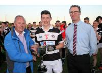 Captain Adam Lynch receive cup from Chairman Derry Murphy