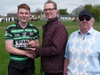 James Holland, Man of the Match U21 A Football Final receives award from Sponsor Kieran Barrett, The Orchard Bar