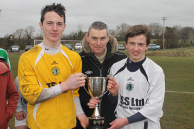 Eany joint captains Gavin Mulreany and Peadar Mogan receive the P.J.Fox U-16 Cup from Ian Curristan
