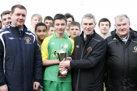 Sam Murphy captain of Bonagee United receives the Under-16 Europa Cup from Donegal Schoolboys chairman Ian Curristan
