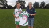 Breeda presenting Captain of senior   team Sarh-Jane Winder with Tesco Jerseys which sh won.