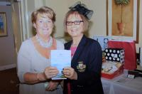 Club President Helen Houlihan presenting Collette Twomey with her raffle prize
