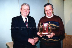 Gerald Fitzgerald accepting the best club award from . NK Scór Officer Jackie Walsh