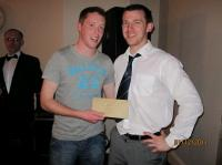 Sean O'Callaghan presents Shane Cotter with his prize