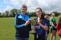 Rachel Condan Scoil Pol recives the Munster PPS Lidl Jun D cup from Dan O Mahony