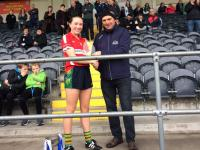 Abbey O Mahony Glanmire Player of the match MLGFA Junior final with president Anthony O Brien