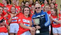 Dave Daly presents Minor A cup to Ciara Hughes Cork