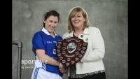 Linda Wall Munster Interpro captain recives shield rom Marie Hickey 2016