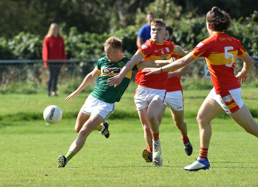Eric Hegarty, St. Michael's getting in his shot on goal despite the attention of Eire Óg players John Cooper and Daire McCarthy. Picture: Dan Linehan